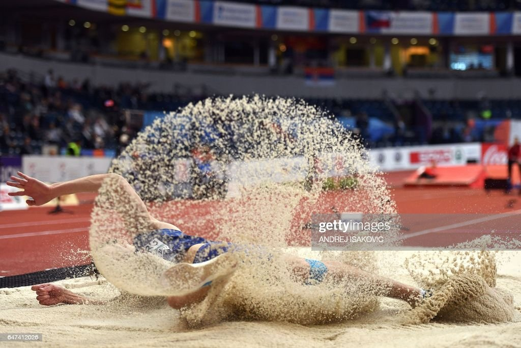 TOPSHOT - Estonia's Henrik Kutberg competes in the men's long jump qualifications at the 2017 European Athletics Indoor Championships in Belgrade on March 3, 2017. / AFP PHOTO / Andrej ISAKOVIC