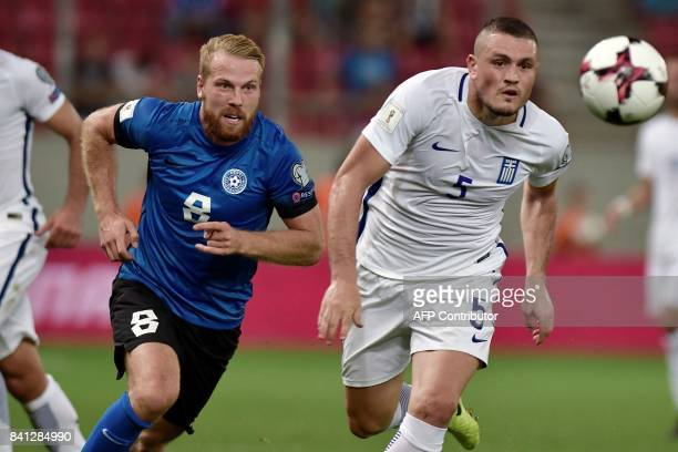Estonia's Hnri Anier vies with Greece's Kyriakos Papadopoulos during the 2018 FIFA World Cup qualifying football match between Greece and Estonia on...