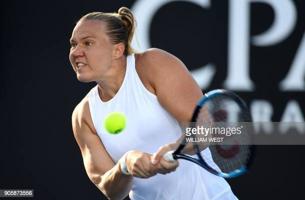 Estonia's Kaia Kanepi plays a backhand return to Puerto Rico's Monica Puig during their women's singles second round match on day three of the...