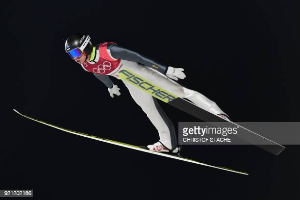 Estonia's Kristjan Ilves competes in the nordic combined men's individual LH/10km jumping competition at the Alpensia ski jump centre during the...