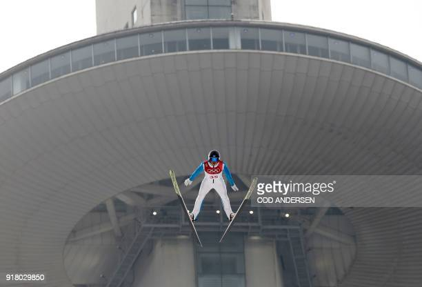 Estonia's Kristjan Ilves competes in the nordic combined men's individual NH/10km jumping trial round at the Alpensia ski jump centre during the...
