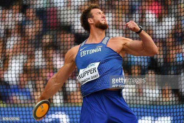 Estonia's Martin Kupper competes in the qualifying round of the men's discus throw athletics event at the 2017 IAAF World Championships at the London...