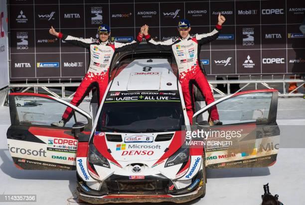 TOPSHOT Estonia's Ott Tanak driver and his compatriot Martin Jarveoja codriver celebrate on the final second podium of the WRC Chile 2019 in...