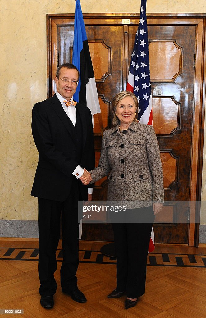 Estonia's President Toomas Hendrik Ilves (L) shakes hands with US Secretary of State Hillary Clinton after the North Atlantic Council meeting with non-NATO ISAF contributors during the informal NATO Foreign Ministers meeting in Tallinn on April 23, 2010. NATO foreign ministers sealed Friday a plan for international troops and civilian staff in Afghanistan to hand over responsibility to the local military and government.