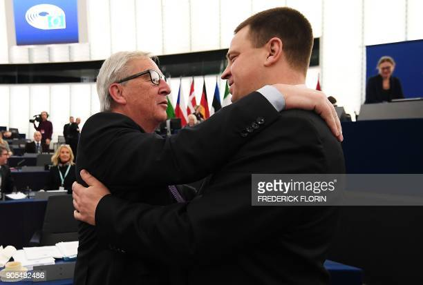 Estonia's Prime Minister Juri Ratas is welcomed by European Commission President JeanClaude Juncker prior to a debate at the European Parliament in...