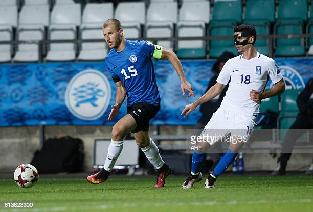 Estonia's Ragnar Klavan vies for the ball with Greece's Petros Mantalos during during the WC 2018 football qualification match between Estonia and...
