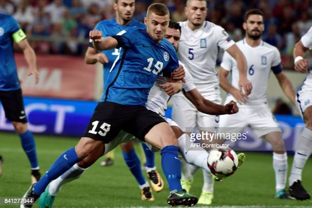 Estonia's Rangan Klavan vies with Greece's Giorgos Tzavellas during the 2018 FIFA World Cup qualifying football match between Greece and Estonia on...