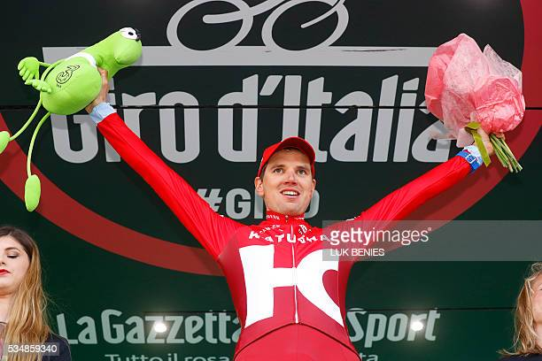 Estonia's Rein Taaramae of team Katusha celebrates on the podium after winning the 20th stage of the 99th Giro d'Italia Tour of Italy from Guillestre...