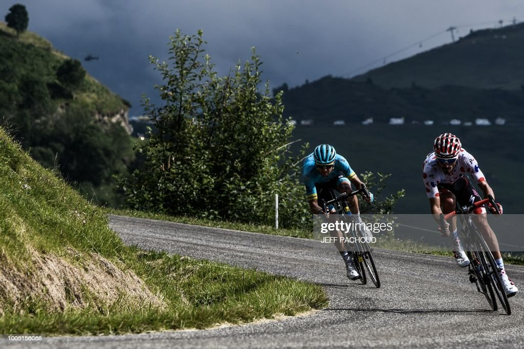 TOPSHOT - Estonia's Tanel Kangert (L) and France's Julian Alaphilippe, wearing the best climber's polka dot jersey, ride downhill during a breakaway in the first pass of the 17th stage of the 105th edition of the Tour de France cycling race, between Bagneres-de-Luchon and Saint-Lary-Soulan Col du Portet, southwestern France, on July 25, 2018.