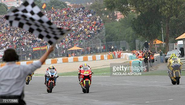 Toni Elias of Spain crosses the finish line in first position followed by Valentino Rossi of Italy and Kenny Roberts of the US during the Moto GP...