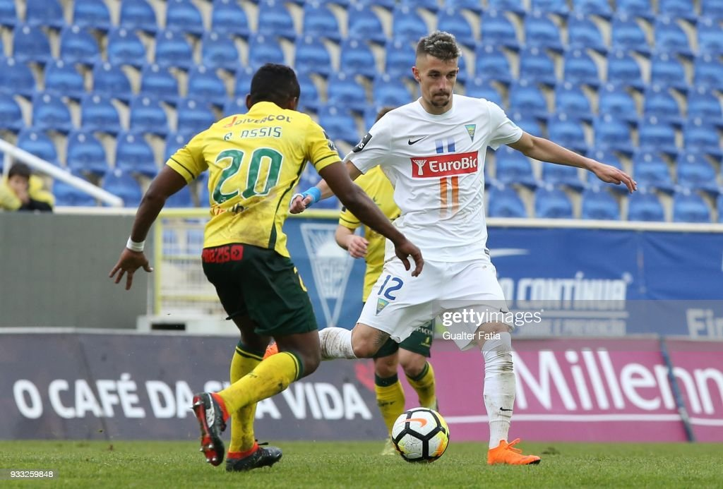 GD Estoril Praia defender Fernando Fonseca from Portugal with FC Pacos de Ferreira midfielder Rafael Assis from Brazil in action during the Primeira Liga match between GD Estoril Praia and FC Pacos de Ferreira at Estadio Antonio Coimbra da Mota on March 17, 2018 in Estoril, Portugal.
