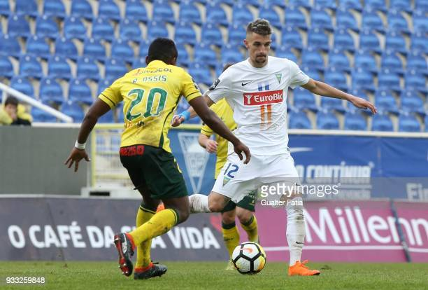 Estoril Praia defender Fernando Fonseca from Portugal with FC Pacos de Ferreira midfielder Rafael Assis from Brazil in action during the Primeira...