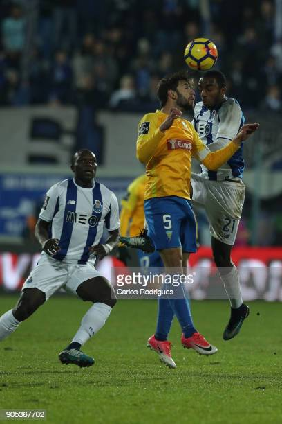 Estoril Praia defender Joel Ferreira from Portugal vies with FC Porto's defender Ricardo Pereira from Portugal for the ball possession during the...