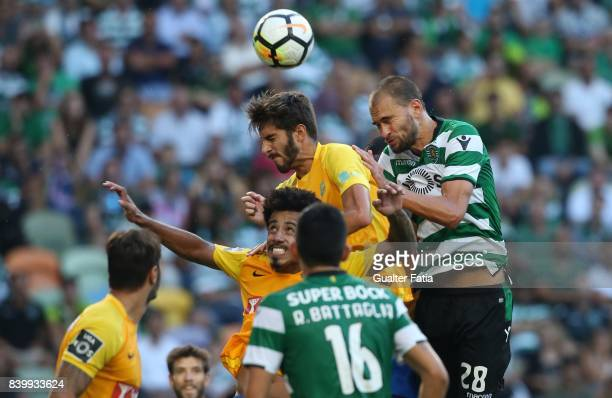 Estoril Praia defender Pedro Monteiro from Portugal with Sporting CP forward Bas Dost from Holland in action during the Primeira Liga match between...
