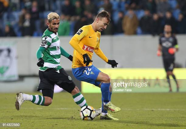 Estoril Praia forward Andre Claro from Portugal with Sporting CP forward Ruben Ribeiro from Portugal in action during the Primeira Liga match between...