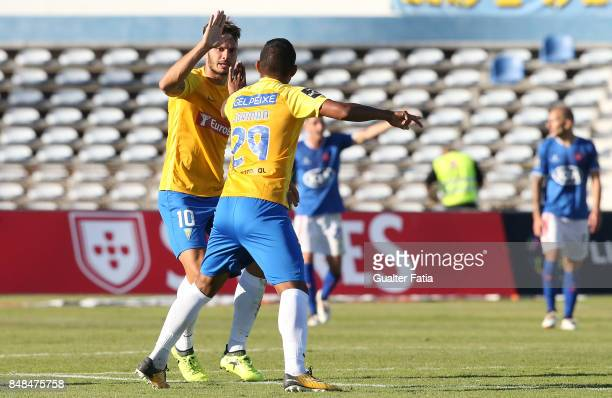 Estoril Praia forward Kleber from Brazil celebrates with teammate GD Estoril Praia forward Jorman Aguilar from Panama after scoring a goal during the...