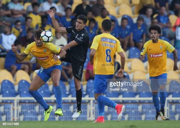 Estoril Praia forward Kleber from Brazil with Vitoria Guimaraes midfielder Guilherme Celis from Colombia in action during the Primeira Liga match...