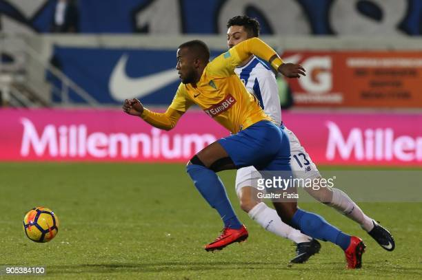Estoril Praia forward Victor Andrade from Brazil with FC Porto defender Alex Telles from Brazil in action during the Primeira Liga match between GD...