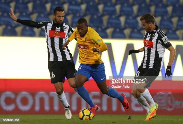 Estoril Praia forward Victor Andrade from Brazil with Portimonense SC defender Ruben Fernandes from Portugal and Portimonense SC midfielder Oriol...