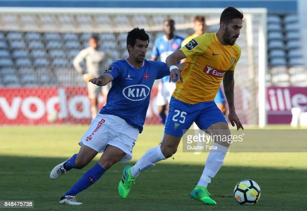 Estoril Praia midfielder Charalampos Kyriakou from Cyprus with CF Os Belenenses forward Miguel Rosa from Portugal in action during the Primeira Liga...