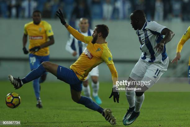 Estoril Praia midfielder Charis Kyriakou from Cyprus vies with FC Porto's forward Moussa Marega from Mali for the ball possession during the match...