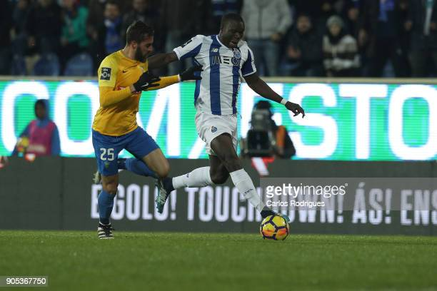 Estoril Praia midfielder Charis Kyriakou from Cyprus vies with FC Porto's forward Vincent Aboubakar from Camaroes for the ball possession during the...