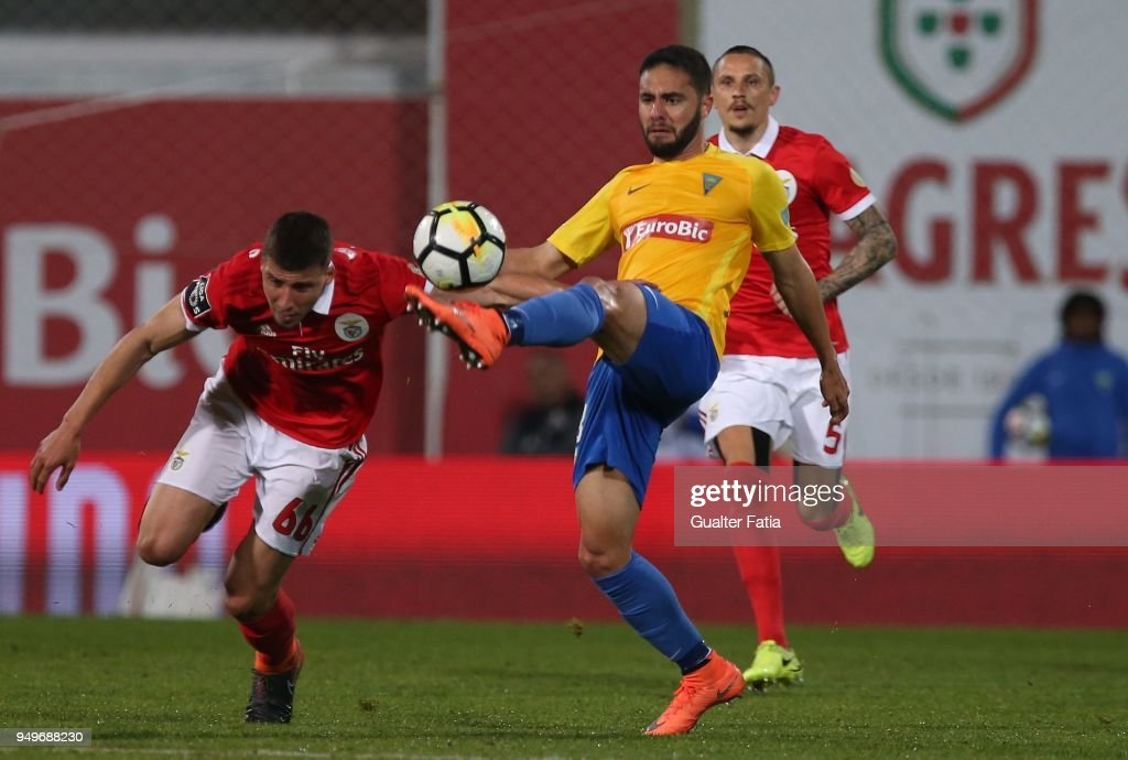 GD Estoril Praia midfielder Eduardo Teixeira from Brazil with SL Benfica defender Ruben Dias from Portugal in action during the Primeira Liga match between GD Estoril Praia and SL Benfica at Estadio Antonio Coimbra da Mota on April 21, 2018 in Estoril, Portugal.