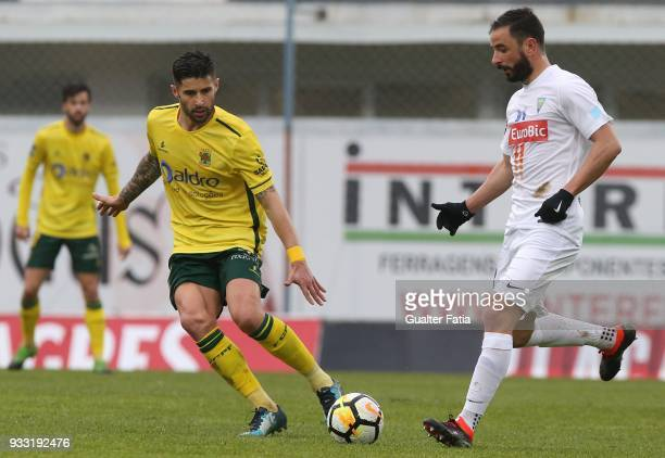 Estoril Praia midfielder Goncalo Santos from Portugal with FC Pacos de Ferreira forward Bruno Moreira from Portugal in action during the Primeira...