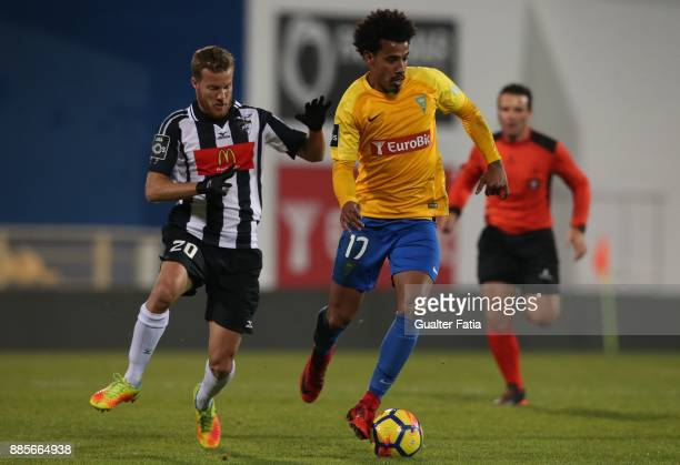 Estoril Praia midfielder Lucas Evangelista from Brazil with Portimonense SC midfielder Oriol Rosell from Spain in action during the Primeira Liga...