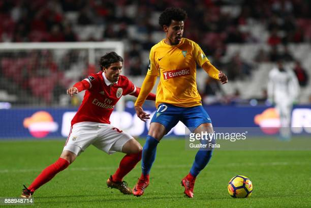 Estoril Praia midfielder Lucas Evangelista from Brazil with SL Benfica midfielder Filip Krovinovic from Croatia in action during the Primeira Liga...