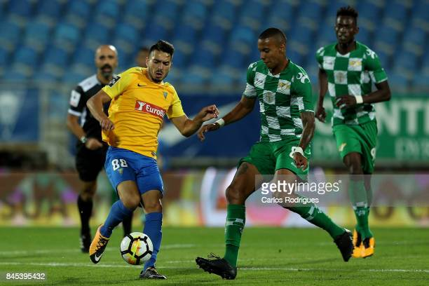 Estoril Praia midfielder Pepe from Portugal vies with Moreirense FC forward Jhonder Cadiz from Venezuela during the match between GD Estoril Praia...