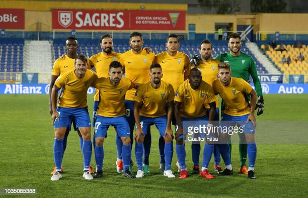 Estoril Praia players pose for a team photo before the start of the Portuguese League Cup match between GD Estoril Praia and CD Feirense at Estadio...
