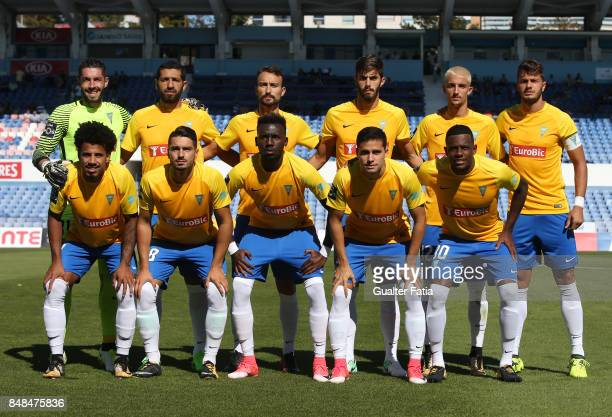 Estoril Praia players pose for a team photo before the start of the Primeira Liga match between CF Os Belenenses and GD Estoril Praia at Estadio do...