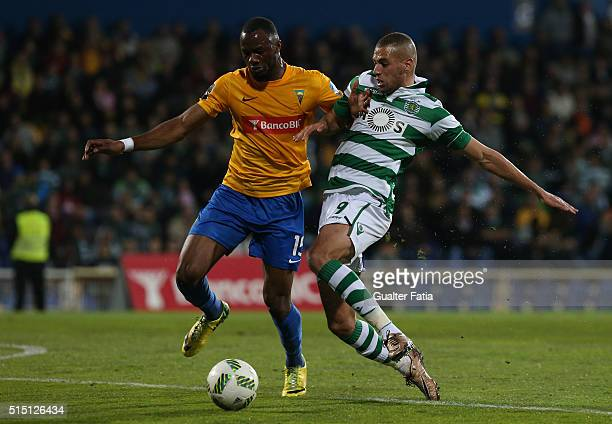 Estoril Praia's defender Oumar Diakhite tackles Sporting CP's forward Islam Slimani from Algeria during the Primeira Liga match between GD Estoril...
