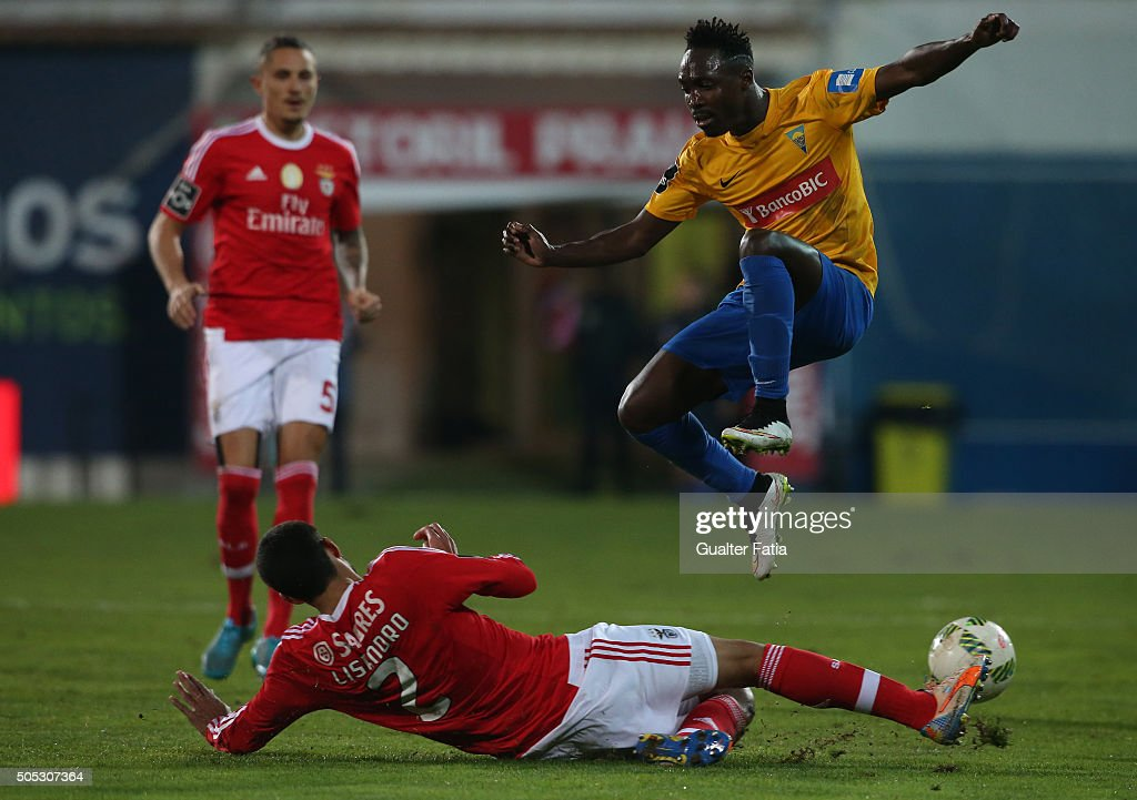 GD Estoril Praia's forward Gerso Fernandes with SL Benfica's argentinian defender Lisandro Lopez in action during the Primeira Liga match between GD Estoril Praia and SL Benfica at Estadio Antonio Coimbra da Mota on January 16, 2016 in Estoril, Portugal.