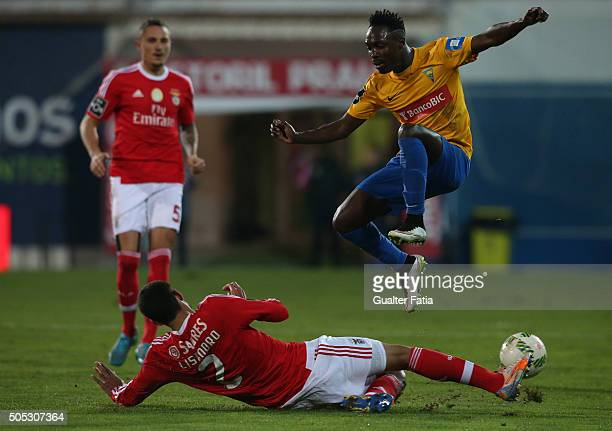 Estoril Praia's forward Gerso Fernandes with SL Benfica's argentinian defender Lisandro Lopez in action during the Primeira Liga match between GD...