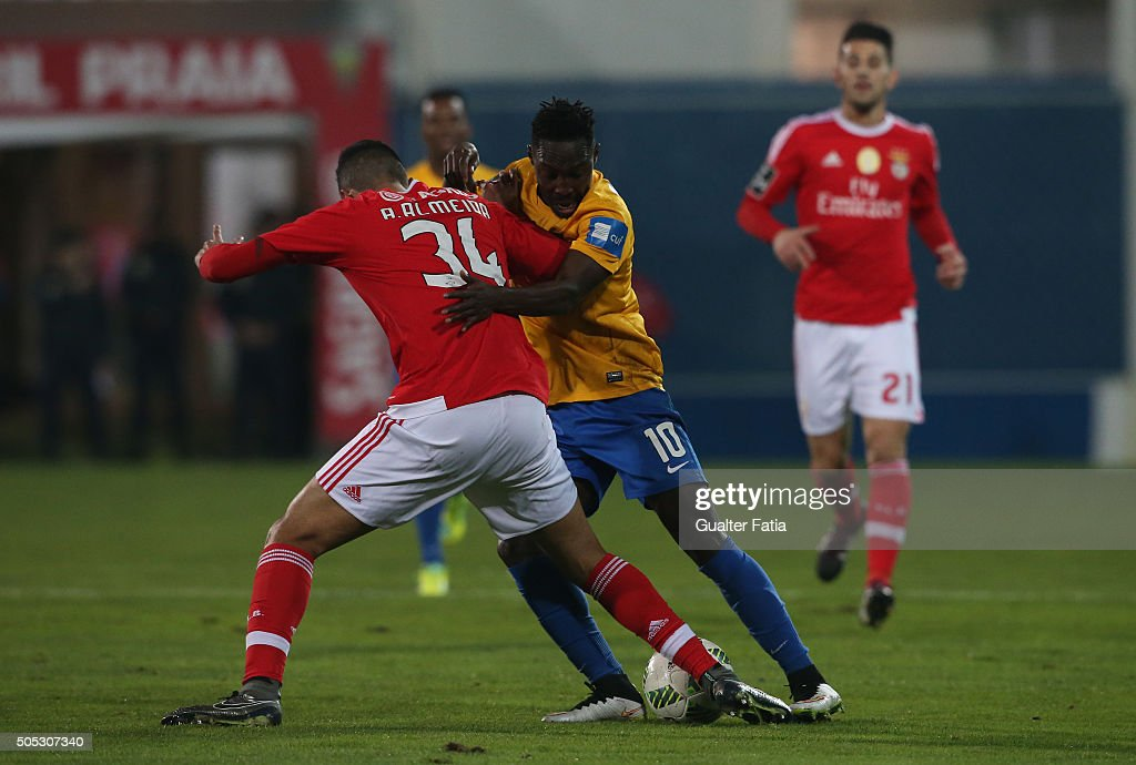 GD Estoril Praia's forward Gerso Fernandes with SL Benfica's defender Andre Almeida in action during the Primeira Liga match between GD Estoril Praia and SL Benfica at Estadio Antonio Coimbra da Mota on January 16, 2016 in Estoril, Portugal.