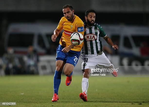 Estoril Praia's midfielder Bruno Cesar with Vitoria Setubal's forward Costinha in action during the Primeira Liga match between Vitoria Setubal and...