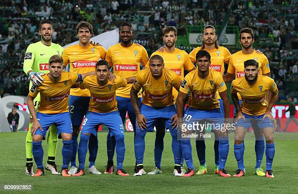 Estoril Praia's players pose for a team photo before the start of the Primeira Liga match between Sporting CP and Estoril Praia at Estadio Jose...