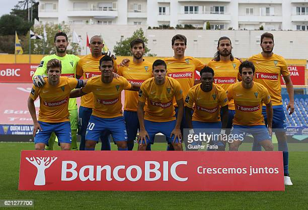 Estoril Praia's players pose for a team photo before the start of the Primeira Liga match between GD Estoril Praia and CD Tondela at Estadio Antonio...
