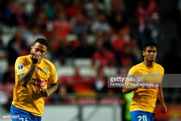 Estoril's Brazilian midfielder Carlinhos de Jesus celebrates a goal during the Portuguese Cup semifinal second leg football match SL Benfica vs GD...