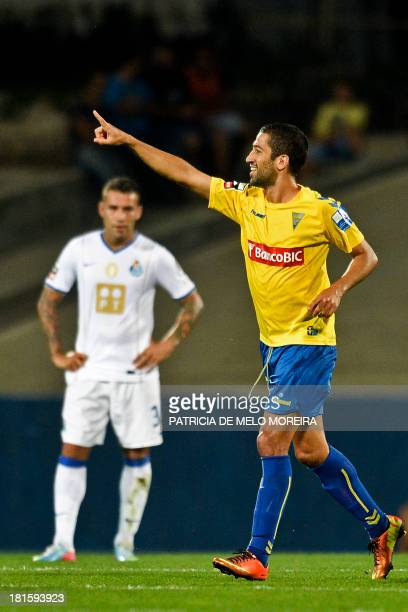 Estoril's Brazilian midfielder Evandro Goebel celebrates after scoring during the Portuguese league football match Estoril vs Porto at the Antonio...