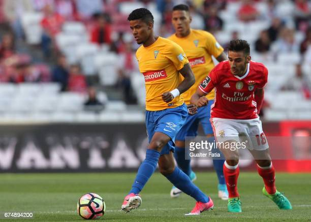 Estoril's defender Ailton Silva from Brazil with SL Benfica's midfielder from Argentina Salvio in action during the Primeira Liga match between SL...