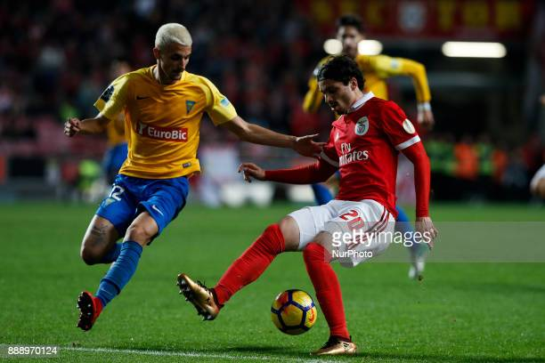 Estoril's defender Fernando Fonseca vies for the ball with Benfica's midfielder Filip Krovinovic during Primeira Liga 2017/18 match between SL...