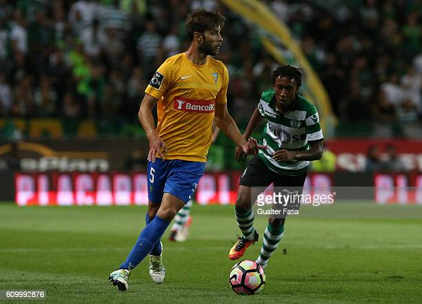 Estoril's defender Joel Ferreira from Portugal with Sporting CP's forward Gelson Martins in action during the Primeira Liga match between Sporting CP...