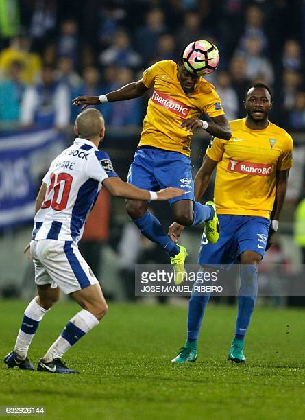 Estoril's defender Mano heads a ball over mate Senegalese defender Oumar Diakhite and Porto's midfielder Andre Andre during the Portuguese league...
