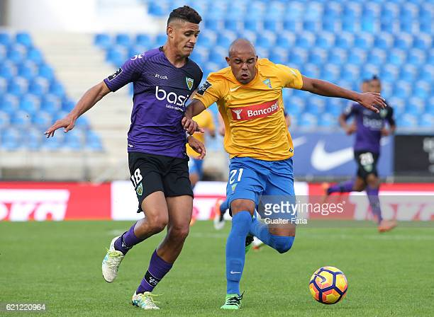 Estoril's defender Thiago Cardoso from Brazil with Tondela's forward Crislan from Brasil in action during the Primeira Liga match between GD Estoril...