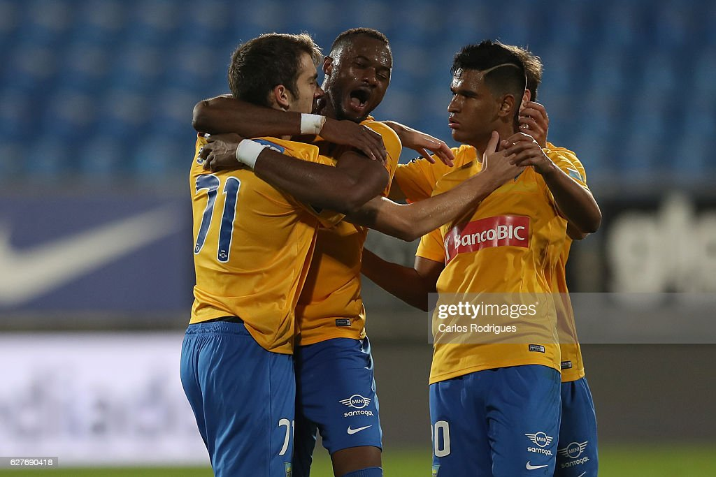 Estoril's forward Konstantin Bazelyuk from Russia celebrates scoring Estoril goal with his team mates during the match between Estoril Praia SAD and CF Os Belenenses for the Portuguese Primeira Liga at Estadio Antonio Coimbra da Mota on August 21, 2016 in Lisbon, Portugal.