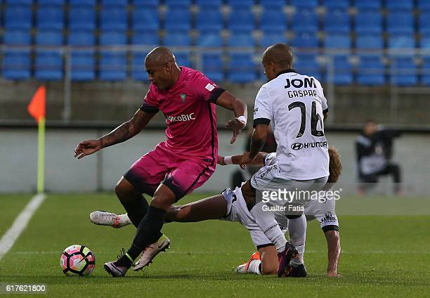 Estoril's forward Paulo Henrique from Brazil with Vitoria Guimaraes' midfielder Rafael Miranda and Vitoria Guimaraes' defender Bruno Gaspar in action...