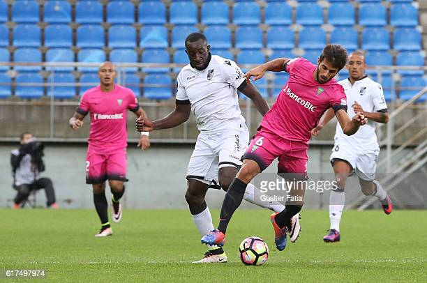 Estoril's midfielder Afonso Taira from Portugal with Vitoria Guimaraes' forward Moussa Marega in action during the Primeira Liga match between GD...